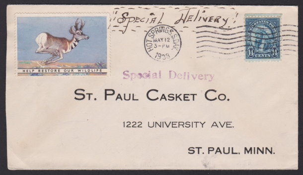 Front of St. Paul Casket Company cover bearing 14-cent American Indian stamp and pronghorn antelope poster stamp