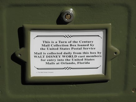 Label indicating Disney staff collect any mail deposited in mailbox