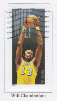Wilt Chamberlain stamp on album page with space too short for the stamp
