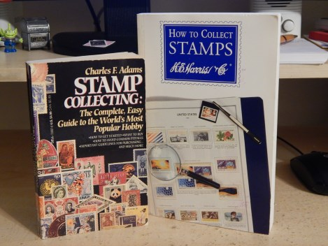 Two stamp collecting books on desk