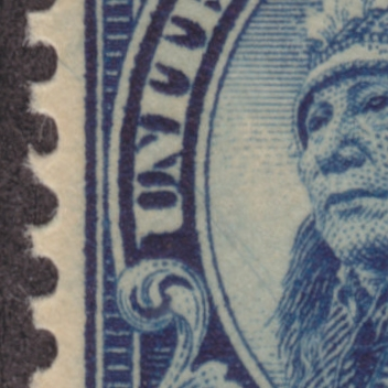 Closeup of 14-cent American Indian stamp with diagonal scratches running across vignette
