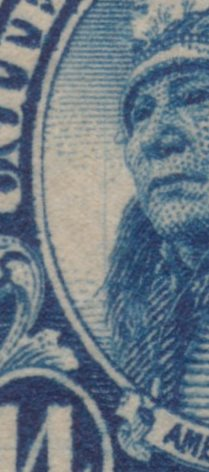 Detail showing vertical scratch to left of face on 14¢ American Indian stamp