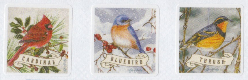 Three Boys Town cinderella stamps picturing a cardinal, a bluebird, and a thrush