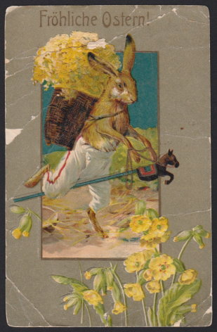 Early 20th century German Easter postcard depicting trouser-clad rabbit carrying flowers and riding a stick horse