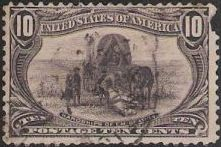 Black 10-cent U.S. postage stamp picturing emigrants with covered wagon