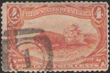 Orange 4-cent U.S. postage stamp picturing Native American hunting buffalo