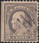 Gray 15-cent U.S. postage stamp picturing Benjamin Franklin