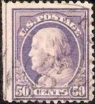 Purple 50-cent U.S. postage stamp picturing Benjamin Franklin