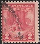 Red 2-cent U.S. postage stamp picturing George Washington kneeling in prayer at Valley Forge