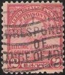 Red 2-cent U.S. postage stamp picturing a lightbulb