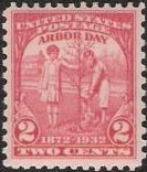 Red 2-cent U.S. postage stamp picturing two children planting a tree