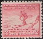 Red 2-cent U.S. postage stamp picturing skier
