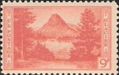 Orange 9-cent U.S. postage stamp picturing Mount Rockwell and Two Medicine Lake