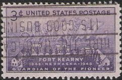 Purple 3-cent U.S. postage stamp picturing settlers with covered wagon and Fort Kearny