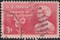 Pink 3-cent U.S. postage stamp picturing Moina Michael and poppies