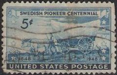 Blue 5-cent U.S. postage stamp picturing covered wagon