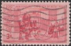 Red 3-cent U.S. postage stamp picturing Betsy Ross with American flag
