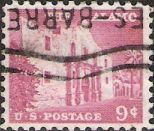 Pink 9-cent U.S. postage stamp picturing the Alamo