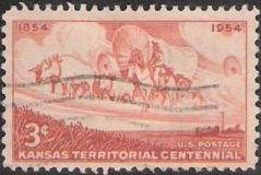 Brown orange 3-cent U.S. postage stamp picturing wagon train and field