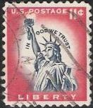 Red and violet blue 11-cent U.S. postage stamp picturing Statue of Liberty