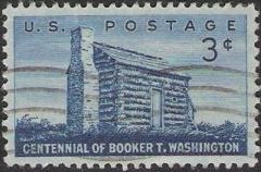 Blue 3-cent U.S. postage stamp picturing log cabin