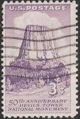 Purple 3-cent U.S. postage stamp picturing Devils Tower