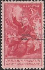 Red 3-cent U.S. postage stamp picturing Benjamin Franklin