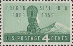 Green 4-cent U.S. postage stamp picturing covered wagon and mountain