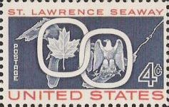 Blue and red 4-cent U.S. postage stamp picturing maple leaf and eagle