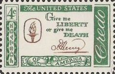 Green and brown 4-cent U.S. postage stamp bearing quote, 'Give me liberty or give me death'