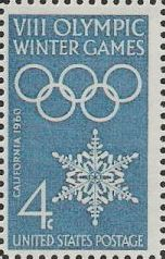 Blue 4-cent U.S. postage stamp picturing Olympic rings and snowflake