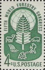 Green 4-cent U.S. postage stamp picturing globe and tree