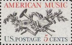 Red and black 5-cent U.S. postage stamp picturing musical instruments