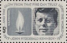 Blue gray 5-cent U.S. postage stamp picturing flame and John F. Kennedy