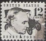 Black 12-cent U.S. postage stamp picturing Henry Ford and car
