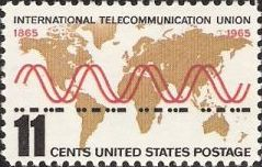 11-cent U.S. postage stamp picturing world map, radio waves, and Morse code