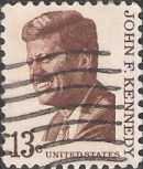 Brown 13-cent U.S. postage stamp picturing John F. Kennedy