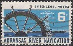 Blue and black 6-cent U.S. postage stamp picturing wheel, power line tower, and barge