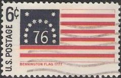 Blue and red 6-cent U.S. postage stamp picturing Bennington flag