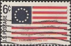 Blue and red 6-cent U.S. postage stamp picturing first 'Stars & Stripes' flag