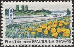 6-cent U.S. postage stamp picturing flowers and highway