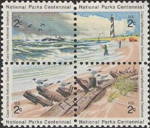 Block of four 2-cent U.S. postage stamps picturing beach scene from Cape Hatteras National Seashore