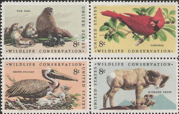 Block of four 8-cent U.S. postage stamps picturing fur seal, cardinal, brown pelican, and bighorn sheep