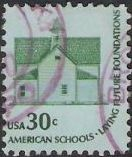 Green and blue 30-cent U.S. postage stamp picturing schoolhouse