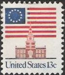 13-cent U.S. postage stamp picturing American flag and Independence Hall