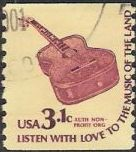Brown 3.1-cent U.S. postage stamp picturing guitar