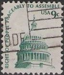 Green 9-cent U.S. postage stamp picturing U.S. Capitol