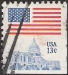 13-cent U.S. postage stamp picturing American flag and U.S. Capitol