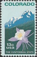 13-cent U.S. postage stamp picturing flower and mountains