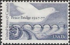 Blue 13-cent U.S. postage stamp picturing dove over Peace Bridge